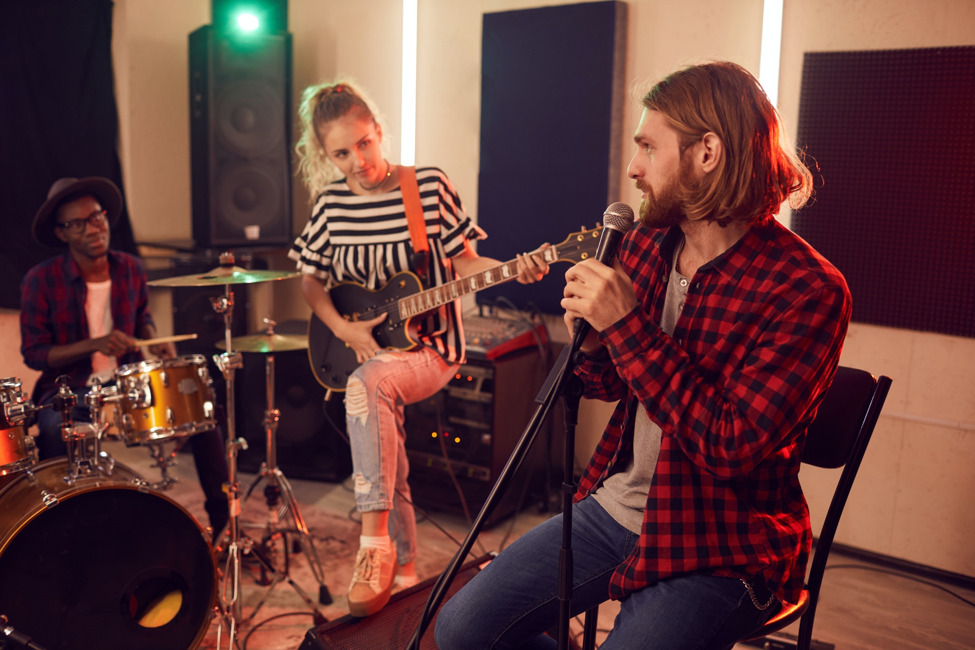 Group of Young People Playing Music in Studio